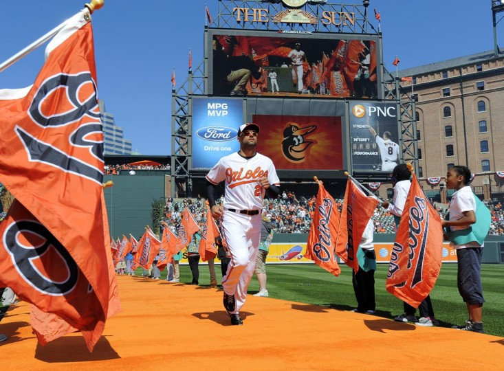 2012: Orioles Nick Markakis is announced onto the field. Baltimore Orioles vs. Minnesota Twins opening day baseball at Camden Yards. (Lloyd Fox/Baltimore Sun)
