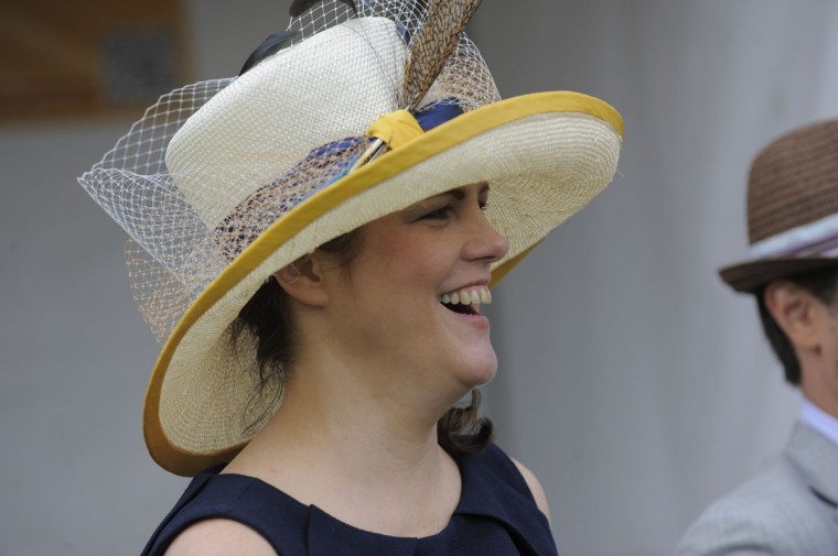 "Christine A. Moore, 47, New York City, milliner. ""Large. Preakness color."" (Lloyd Fox/The Baltimore Sun)"