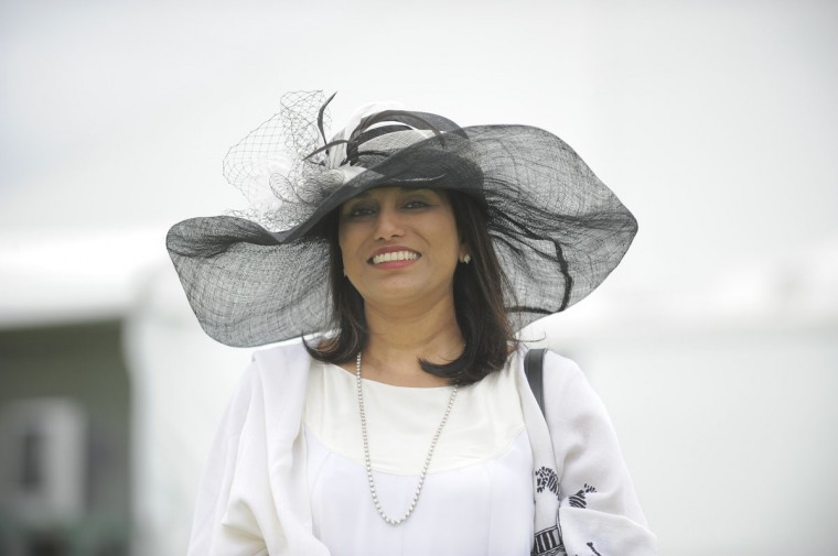 "Seema Sharma, 48, Rockville, technology company. ""Preakness chic."" (Lloyd Fox/The Baltimore Sun)"