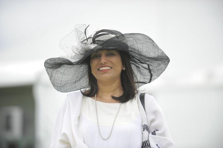 "Seema Sharma, 48, Rockville, technology company. ""Preakness chic."" (Lloyd Fox/The Baltimore Sun)"