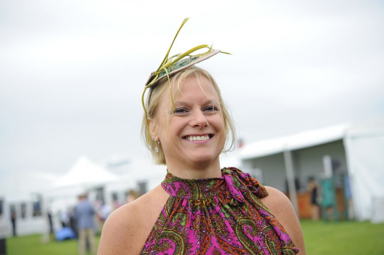 "Pam Healy, 49, Towson, consultant. ""Feather. Fun. Fascinator."" (Lloyd Fox/The Baltimore Sun)"