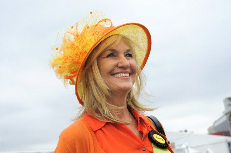 "Stephanie Guidry, 42, Houston, Tx., retired. ""Orange and yellow with fabulous organza."" (Lloyd Fox/The Baltimore Sun)"