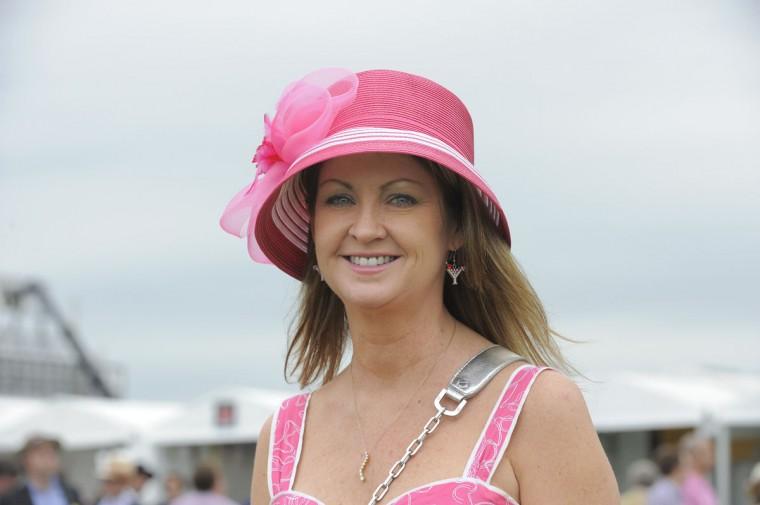 "Kelly Adkins, 47, North Potomac, homemaker. ""Sassy. Hot pink. Sexy. Fun."" (Lloyd Fox/The Baltimore Sun)"