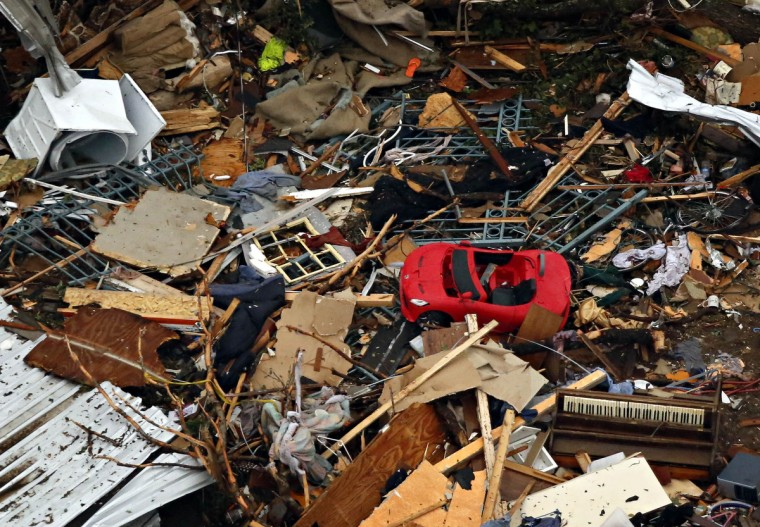 A piano and toy car sit among the rubble of a home on Thursday, May 16, 2013, in Granbury, Texas, after overnight storms sparked tornados and caused damage to the area. (Ron T. Ennis/Fort Worth Star-Telegram/MCT)