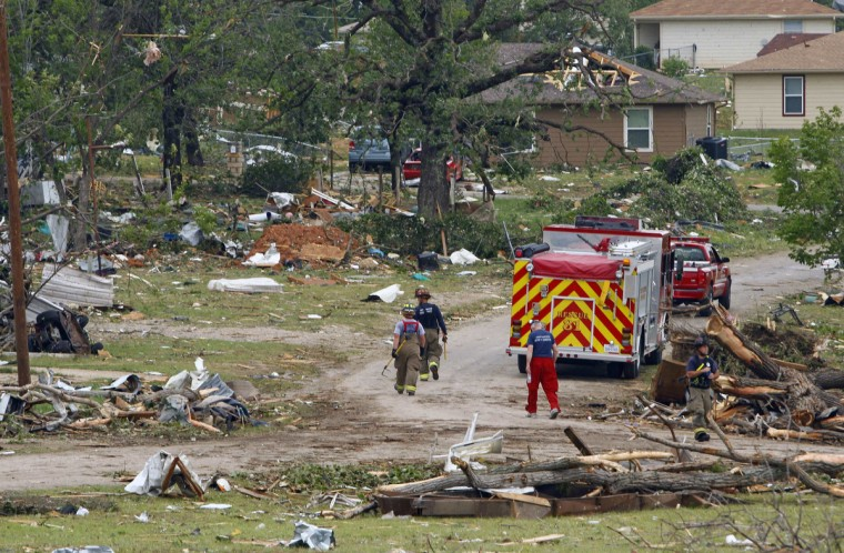 Firefighters walk past debris May 16 after tornados swept through the town of Granbury, Texas late May 15, 2013. At least six people were killed and about 100 injured on Wednesday as three tornadoes ripped through a stretch of Texas near the Dallas-Fort Worth area, destroying a number of homes, authorities said. (Richard Rodriguez/Reuters)