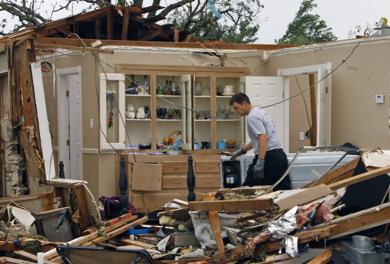 A rescue worker combs through debris May 16 after tornados swept through the town of Granbury, Texas late May 15, 2013. At least six people were killed and about 100 injured on Wednesday as three tornadoes ripped through a stretch of Texas near the Dallas-Fort Worth area, destroying a number of homes, authorities said. (Richard Rodriguez/Reuters)