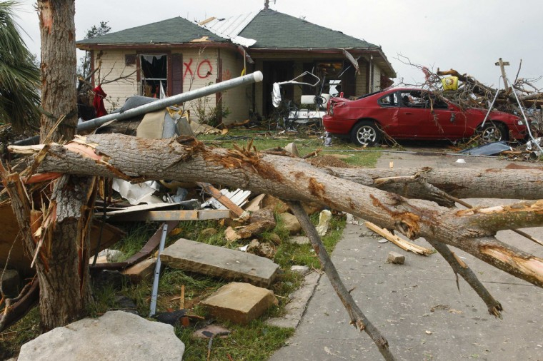 A damaged home and car remain May 16 after tornados swept through the town of Granbury, Texas late May 15, 2013. At least six people were killed and about 100 injured on Wednesday as three tornadoes ripped through a stretch of Texas near the Dallas-Fort Worth area, destroying a number of homes, authorities said. (Richard Rodriguez/Reuters)