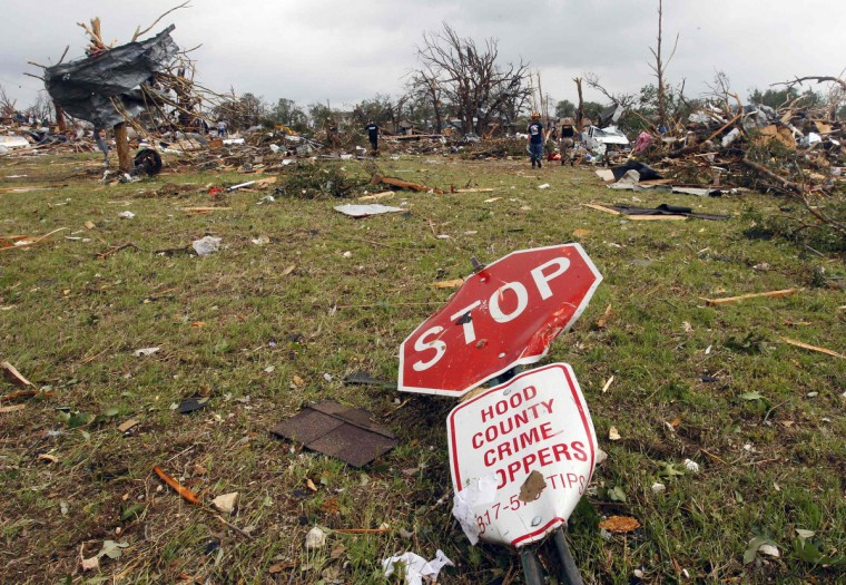 A stop sign lies among debris May 16 after tornados swept through the town of Granbury, Texas late May 15, 2013. At least six people were killed and about 100 injured on Wednesday as three tornadoes ripped through a stretch of Texas near the Dallas-Fort Worth area, destroying a number of homes, authorities said. (Richard Rodriguez/Reuters)
