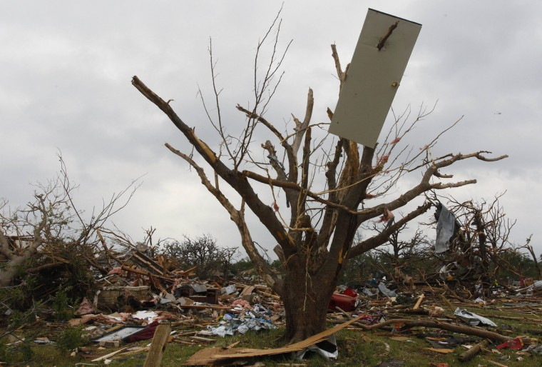 The door of a house is impaled on a tree May 16 after tornados swept through the town of Granbury, Texas late May 15, 2013. At least six people were killed and about 100 injured on Wednesday as three tornadoes ripped through a stretch of Texas near the Dallas-Fort Worth area, destroying a number of homes, authorities said. (Richard Rodriguez/Reuters)
