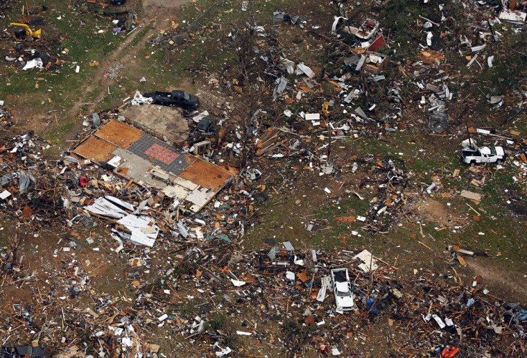 Debris from damaged homes litters the neighborhood on Thursday, May 16, 2013, in Granbury, Texas, after overnight storms sparked tornados and caused damage to the area. Ron T. Ennis/Fort Worth Star-Telegram/MCT)