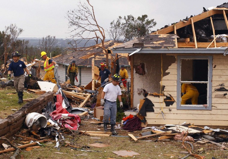 Rescue workers comb through debris May 16, 2013 after tornados swept through the town of Granbury, Texas late May 15. At least six people were killed and about 100 injured on Wednesday as three tornadoes ripped through a stretch of Texas near the Dallas-Fort Worth area, destroying a number of homes, authorities said. (Richard Rodriguez/Reuters)