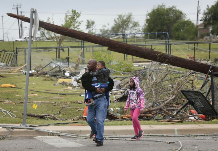 Residents survey the damage to their neighborhood on Thursday, May 16, 2013, in Cleburne, Texas, after overnight storms sparked tornadoes and caused damage to the area. (Michael Ainsworth/Dallas Morning News/MCT)