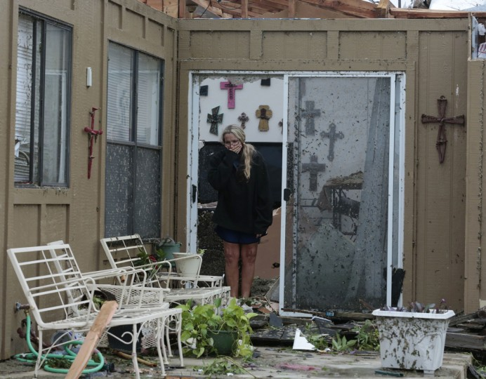 Lisa Montgomery looks over her the patio of of her home that had its roof torn away on Thursday, May 16, 2013, in Cleburne, Texas, after overnight storms sparked tornadoes and caused damage to the area. (Michael Ainsworth/Dallas Morning News/MCT)