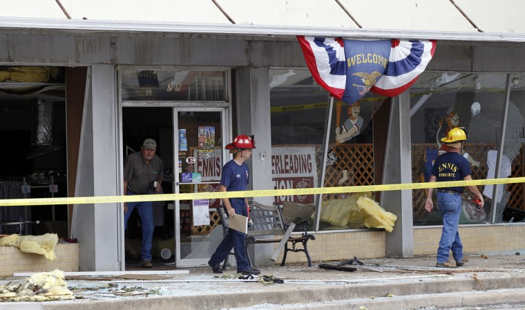 Firefighters survey damage in downtown Ennis, Texas, Thursday, May 16, 2013. A storm passed through Ennis and damaged many areas along Ennis Avenue. (Vernon Bryant/Dallas Morning News/MCT)