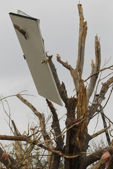 A door is suspended on a tree limb on Thursday, May 16, 2013, in Granbury, Texas, after overnight storms sparked tornados and caused damage to the area. (Paul Moseley/Fort Worth Star-Telegram/MCT)