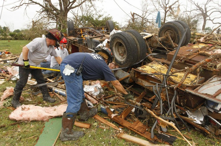 Rescue workers comb through debris after tornados swept through the town of Granbury, Texas May 16, 2013. At least six people were killed and about 100 injured on Wednesday as three tornadoes ripped through a stretch of Texas near the Dallas-Fort Worth area, destroying a number of homes, authorities said. (Richard Rodriguez/Reuters)