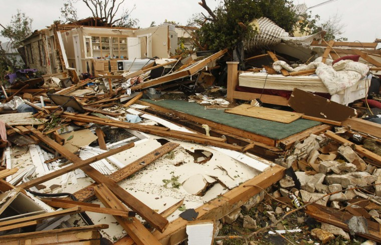 Rubble remains after a home was destroyed by tornados in town of Granbury, Texas May 16, 2013. At least six people were killed and about 100 injured on Wednesday as three tornadoes ripped through a stretch of Texas near the Dallas-Fort Worth area, destroying a number of homes, authorities said. (Richard Rodriguez/Reuters)