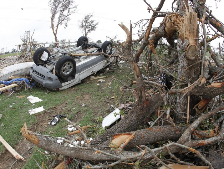 Wrecked vehicles and mangled trees are all over the neighborhood on Thursday, May 16, 2013, in Granbury, Texas, after overnight storms sparked tornados and caused damage to the area. (Paul Moseley/Fort Worth Star-Telegram/MCT)
