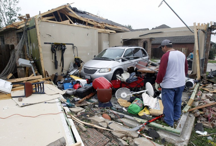 Pete Alaniz looks over the remains of his home on Thursday, May 16, 2013, in Cleburne, Texas, after overnight storms sparked tornadoes and caused damage to the area. (Michael Ainsworth/Dallas Morning News/MCT)