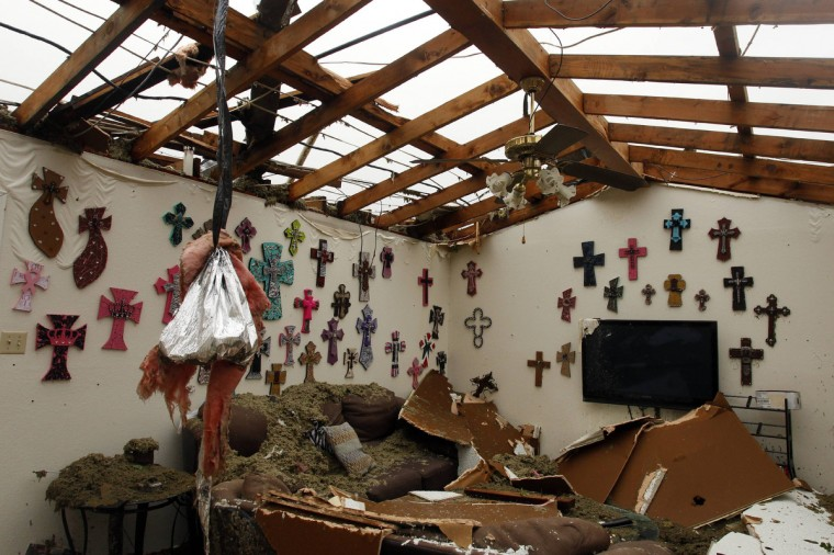 The living room of a home that had its roof blown off by a tornado is pictured in Cleburne, Texas May 16, 2013. At least six people were killed and seven were missing after as many as 10 tornadoes ripped through north-central Texas Wednesday evening, leaving a trail of destruction from the worst severe storm outbreak in the United States so far this year. (Richard Rodriguez/Reuters)
