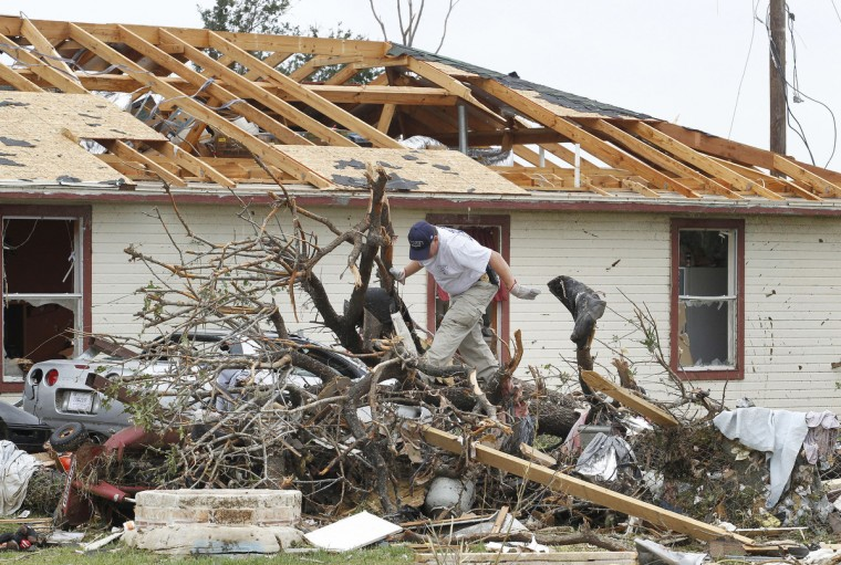People survey the damage on Thursday, May 16, 2013, in Granbury, Texas, after overnight storms sparked tornados and caused damage to the area. (Paul Moseley/Fort Worth Star-Telegram/MCT)