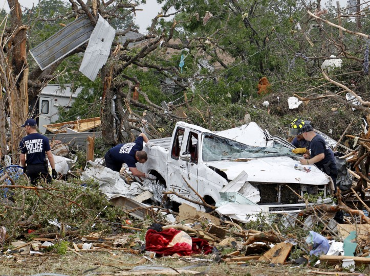 Emergency personnel search around a crushed truck on Thursday, May 16, 2013, in Granbury, Texas, after overnight storms sparked tornadoes and caused damage to the area. (Paul Moseley/Fort Worth Star-Telegram/MCT)