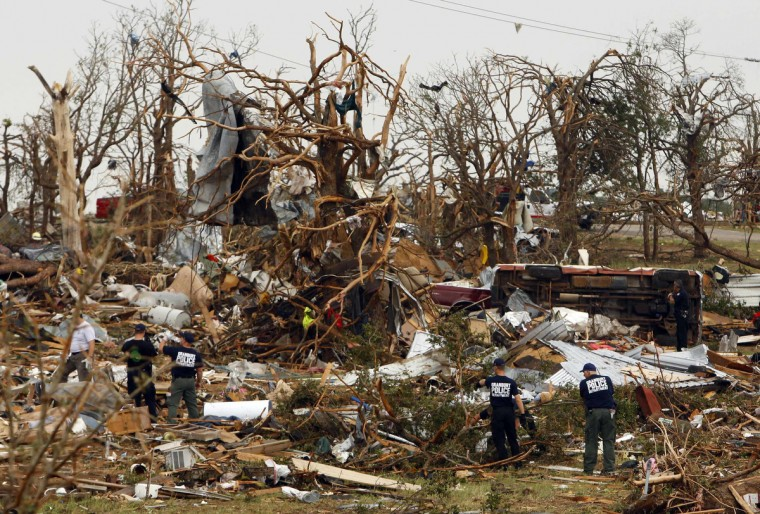 Rescue workers comb through debris May 16 after tornados swept through the town of Granbury, Texas late May 15, 2013. At least six people were killed and about 100 injured on Wednesday as three tornadoes ripped through a stretch of Texas near the Dallas-Fort Worth area, destroying a number of homes, authorities said. (Richard Rodriguez/Reuters)