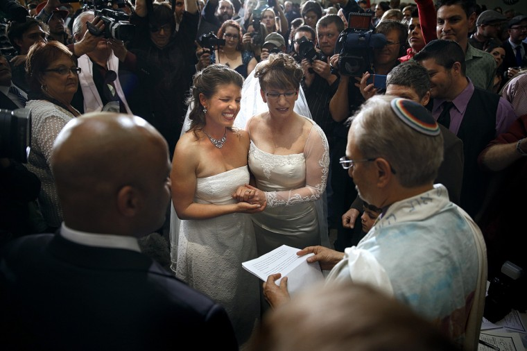 Anna (L) and Fran Simon, both of Denver, Colorado, are the first same-sex couple to be issued a Civil Union license at a midnight ceremony in the Denver Office of the Clerk and Recorder, at the Wellington E. Webb Municipal Office Building on May 1, 2013 in Denver, Co. Colorado is the eighth state to have civil unions or similar laws implemented, permitting unmarried couples, both gay and heterosexual, the ability to form civil unions and get similar rights to those of married couples. (Marc Piscotty/Getty Images)