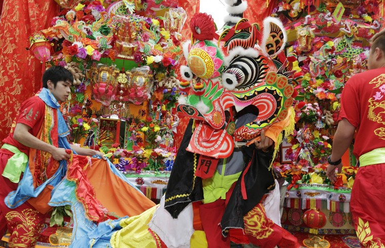 A person in Chinese lion costume dances by Tin Hau Temple, at the village of Shap Pat Heung as people celebrate and pay respects to Tin Hau on her Birthday in Hong Kong, Hong Kong. Tin Hau is a gooddess of the sea and revered by fisherman and many Hong Kong people. (Jessica Hromas/Getty Images)