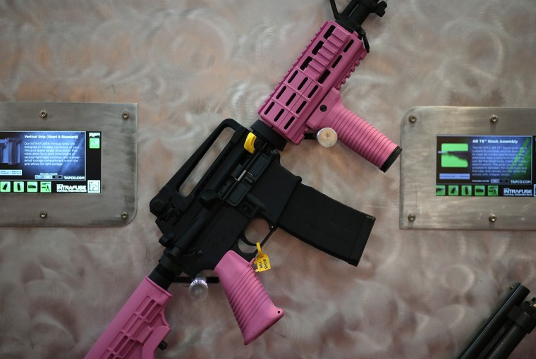 An assault rifle with pink highlights is displayed during the 2013 NRA Annual Meeting and Exhibits at the George R. Brown Convention Center. (Justin Sullivan/Getty Images)