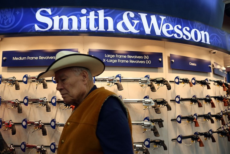 An attendee walks through the Smith and Wesson booth during the 2013 NRA Annual Meeting and Exhibits at the George R. Brown Convention Center. (Justin Sullivan/Getty Images)