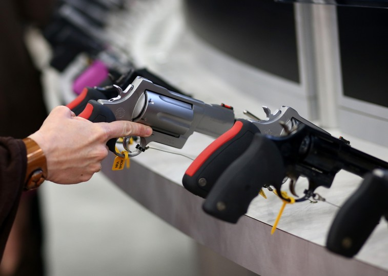 An attendee inspects a handgun during the 2013 NRA Annual Meeting and Exhibits at the George R. Brown Convention Center on May 3, 2013 in Houston, Texas. (Justin Sullivan/Getty Images)