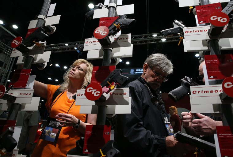 Attendees look at a display of handguns during the 2013 NRA Annual Meeting and Exhibits at the George R. Brown Convention Center on May 3, 2013 in Houston, Texas. (Justin Sullivan/Getty Images)