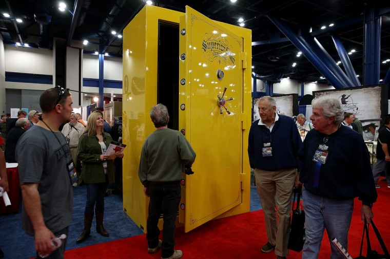 Attendees look at a giant gun safe during the 2013 NRA Annual Meeting and Exhibits at the George R. Brown Convention Center on May 3, 2013 in Houston, Texas. (Justin Sullivan/Getty Images)