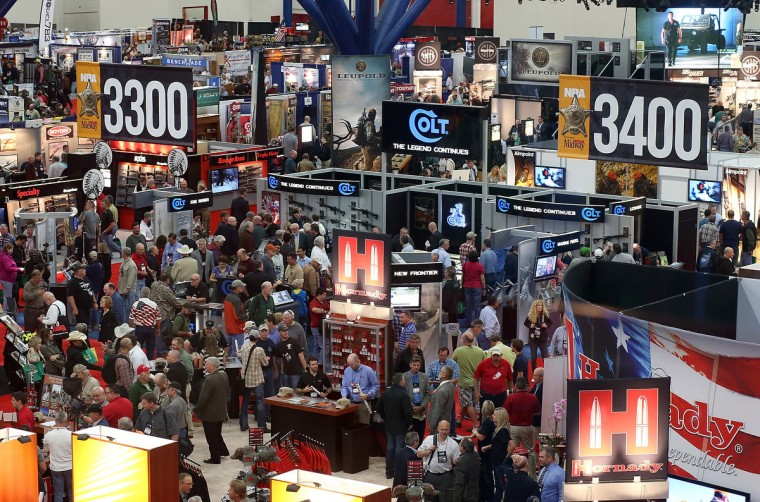 Attendees walk on the show floor during the 2013 NRA Annual Meeting and Exhibits at the George R. Brown Convention Center on May 3, 2013 in Houston, Texas. (Justin Sullivan/Getty Images)