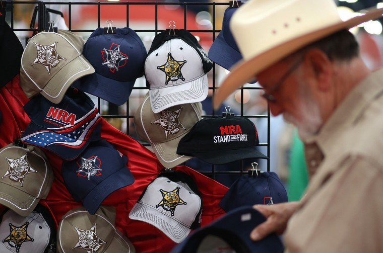 An attendee looks at a display of NRA hats during the 2013 NRA Annual Meeting and Exhibits at the George R. Brown Convention Center on May 3, 2013 in Houston, Texas. (Justin Sullivan/Getty Images)