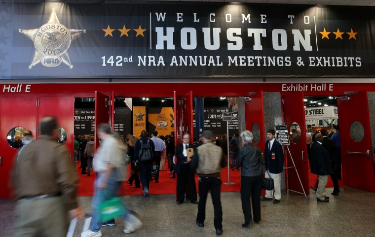 Attendees enter the 2013 NRA Annual Meeting and Exhibits at the George R. Brown Convention Center on May 3, 2013 in Houston, Texas. (Justin Sullivan/Getty Images)