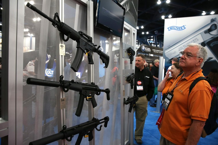 An attendee looks at a display of assault rifles during the 2013 NRA Annual Meeting and Exhibits at the George R. Brown Convention Center on May 3, 2013 in Houston, Texas. (Justin Sullivan/Getty Images)