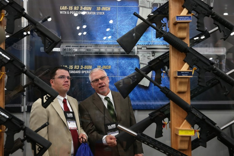 Attendees look at a display of assault rifles during the 2013 NRA Annual Meeting and Exhibits at the George R. Brown Convention Center on May 3, 2013 in Houston, Texas. (Justin Sullivan/Getty Images)