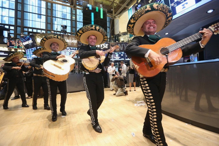 The band Mariachi Real de Mexico performs on the floor of the New York Stock Exchange ahead of the Cinco de Mayo holiday after the closing bell on May 3, 2013 in New York City. The Dow Jones Industrial Average briefly eclipsed 15,000 before settling at 14,973.96, a record high, following positive jobs numbers. (Mario Tama/Getty Images)