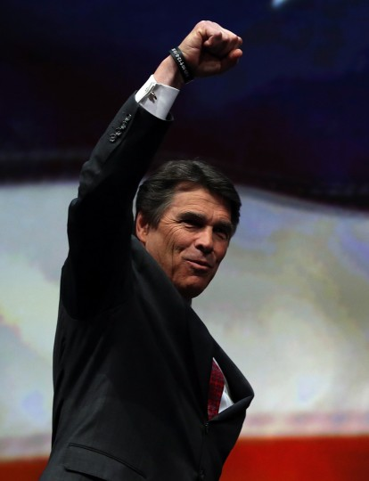 Texas Gov. Rick Perry pumps his fist before speaking during the 2013 NRA Annual Meeting and Exhibits at the George R. Brown Convention Center on May 3, 2013 in Houston, Texas. (Justin Sullivan/Getty Images)