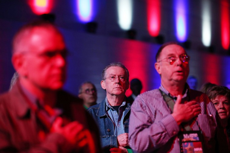 Attendees recite the pledge of allegiance during the 2013 NRA Annual Meeting and Exhibits at the George R. Brown Convention Center on May 3, 2013 in Houston, Texas. (Justin Sullivan/Getty Images)