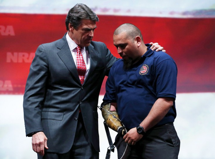 Texas Gov. Rick Perry (L) greets a wounded veteran during the 2013 NRA Annual Meeting and Exhibits at the George R. Brown Convention Center on May 3, 2013 in Houston, Texas. (Justin Sullivan/Getty Images)
