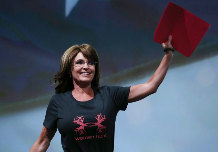 Former Alaska Gov. Sarah Palin waves before speaking during the 2013 NRA Annual Meeting and Exhibits at the George R. Brown Convention Center on May 3, 2013 in Houston, Texas. (Justin Sullivan/Getty Images)