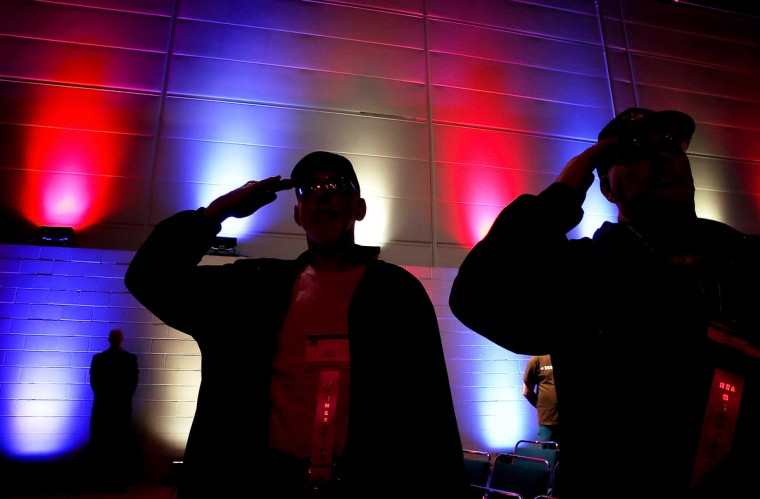 Attendees salute during the pledge of allegiance during the 2013 NRA Annual Meeting and Exhibits at the George R. Brown Convention Center on May 3, 2013 in Houston, Texas. (Justin Sullivan/Getty Images)