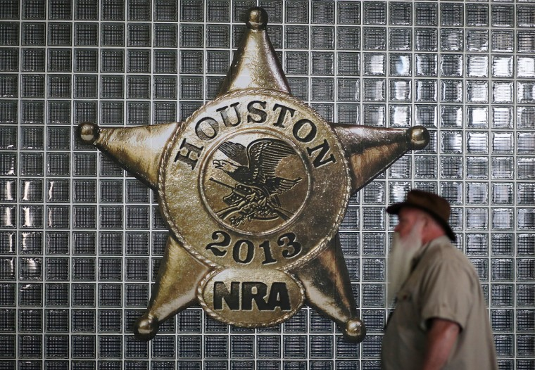 An attendee walks by a sign during the 2013 NRA Annual Meeting and Exhibits at the George R. Brown Convention Center on May 3, 2013 in Houston, Texas. (Justin Sullivan/Getty Images)