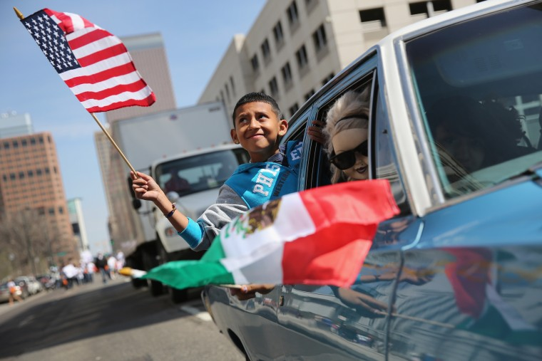A boy rides in a low rider during a Cinco de Mayo parade in Denver, Colorado. Hundreds of thousands of people were expected to attend the two day event, billed as the largest Cinco de Mayo celebration in the United States. Cinco de Mayo observes the victory of the Mexican army over French forces on May 5, 1862 in the town of Puebla, Mexico. The festival celebrates Mexican culture and is one of the most popular annual Latino events in the United States. (John Moore/Getty Images)