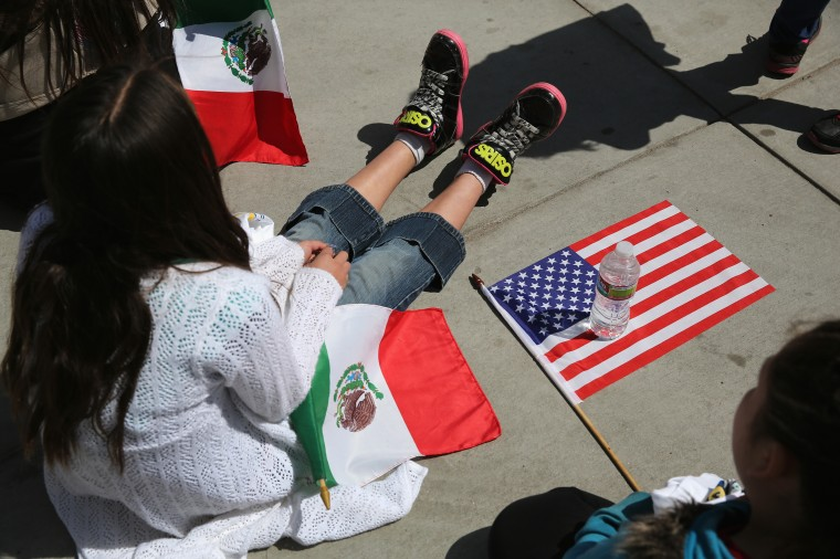 Girl scouts with Mexican and American flags rest after walking in a Cinco de Mayo parade in Denver, Colorado. (John Moore/Getty Images)
