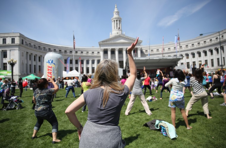 Women dance zumba at a Cinco de Mayo festival at Denver's Civic Center Park in Denver, Colorado. (John Moore/Getty Images)