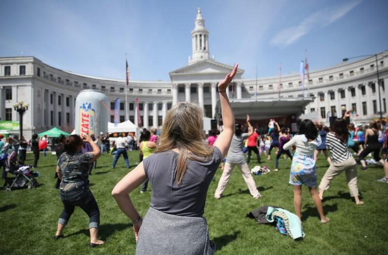 Women dance zumba at a Cinco de Mayo festival at Denver's Civic Center Park in Denver, Colorado. (John Moore/Getty Images)